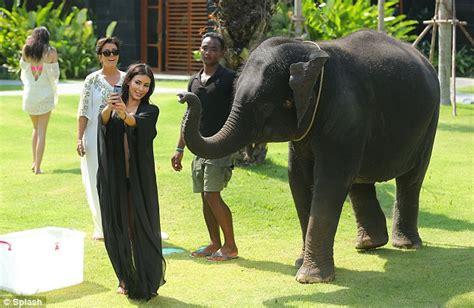 kim kardashian and elephant kim kardashian runs in fear as unimpressed elephant reacts