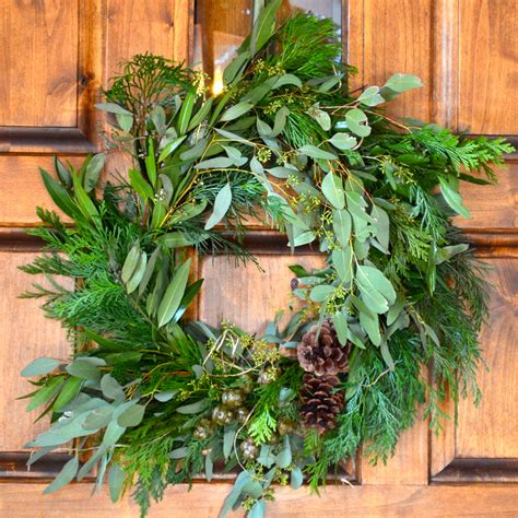 learn to make your own holiday wreath diy tutorial with