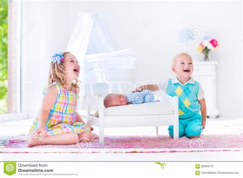 when to put baby in toddler bed kids playing with new born baby brother stock image