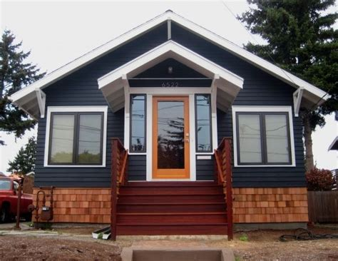 blue exterior house paint with orange stripe and black dark gray house with natural wood trim outdoor google