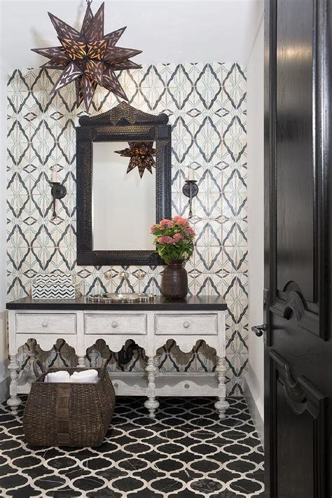 moroccan style powder room  black marble quatrefoil