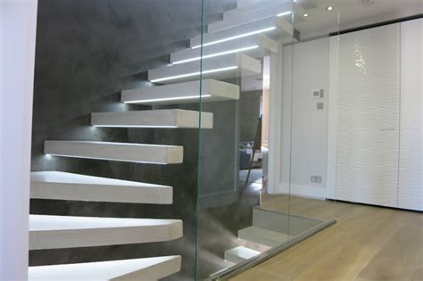 Tailor made Hanging Beton Cire Stairs and Feature Wall Modern Staircase london by Modern