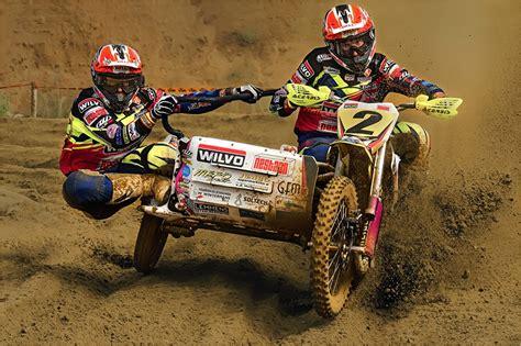 d motocross image motocross helmet two sport motorcycles mud