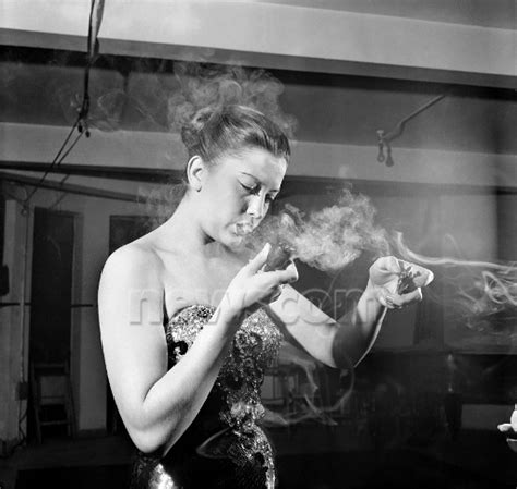 a singer in a smoky room pipe lovin
