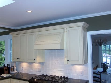 hood cabinet kitchen cabinets above stove custom antiqued white cabinets range hood traditional other