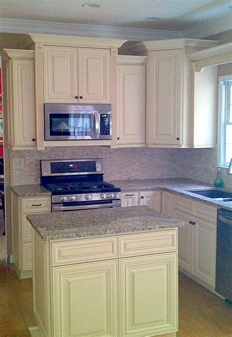 staggered kitchen cabinets staggered wall mounted cabinets create a huge sense of