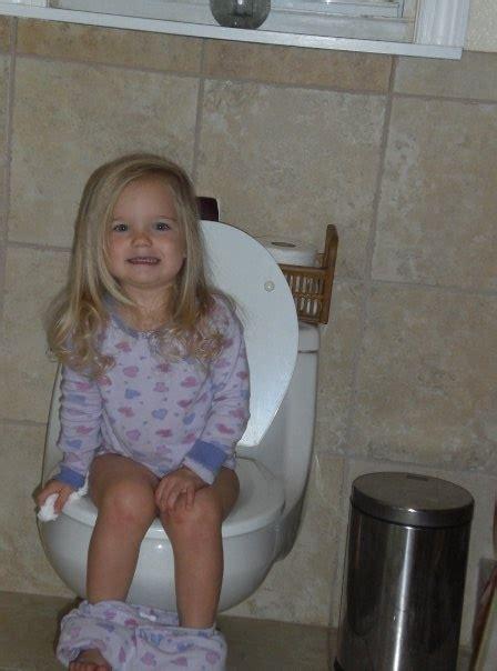 girl on toilet potty training how to potty train potty training pinterest