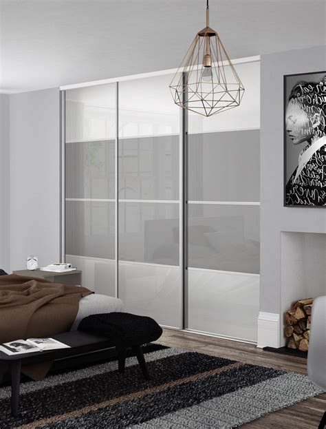 Glass Door Wardrobe Designs by Classic 4 Panel Sliding Wardrobe Doors In White And