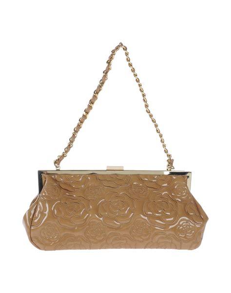Clutch Bag Tosca tosca handbag in brown lyst