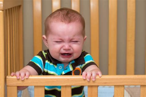 baby cries in crib let a baby cry for better sleep say researchers