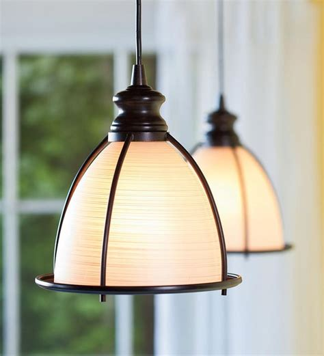 Best Pendant Lights For Kitchen Island by In Brushed Bronze And Glass Cage Pendant Light