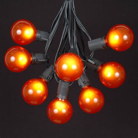 100 orange g50 globe string light set on black wire