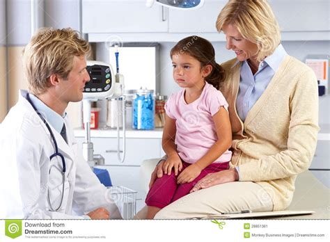 motherhood medicine and a doctor s journey of finding calm in the chaos books and child visiting doctor s office stock image