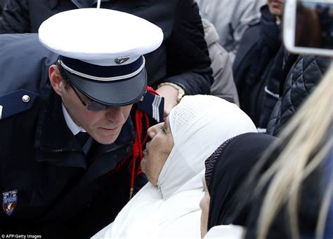 paris policeman s brother islam is a religion of mother leads mourners as france buries police officers