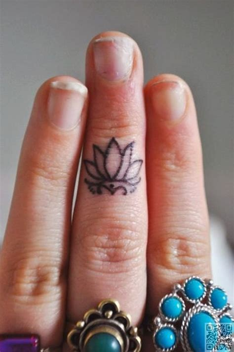 lotus finger tattoo 25 best ideas about tiny finger tattoos on