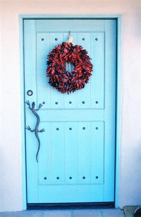 southwest style southwest style pueblo desert adobe home blue door chili