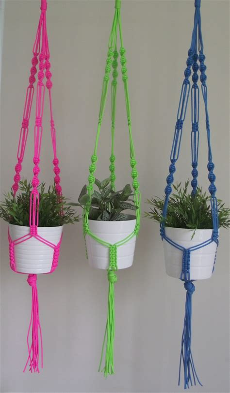 neon pink macrame pot plant hanger the coloured knot