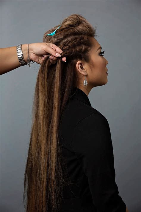 top of head braided back with sides and back shaved day to night hairstyle mohawk braid into fishtail bun