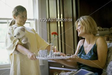 how to get in bed with your mom stock photo mother getting breakfast in bed image