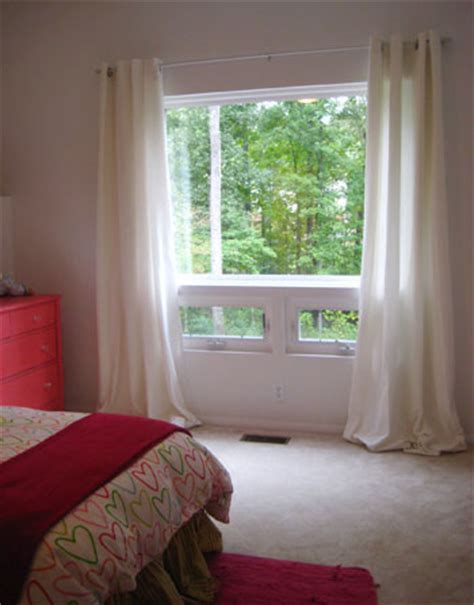 hang curtains higher than window hang curtains wide and high over a window to add polish