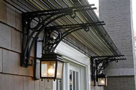 wrought iron awning brackets steel trellis traditional exterior baltimore by melville thomas architects inc