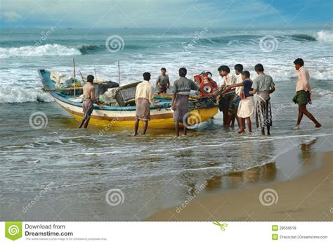 poor boat poor indian fishermen pushed the boat for water orissa