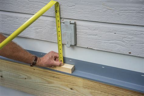 anchor roof into vinyl siding how to attach ledger board for a deck decks