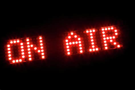 On Air In the words on air in illuminated light bulbs photograph