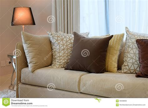 grey patterned couch brown tweed sofa with grey patterned pillows stock photo