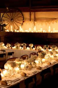 tablescape for a wedding reception with a barn as the