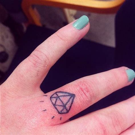diamond tattoo on ring finger meaning 75 attractive finger tattoos for women golfian com
