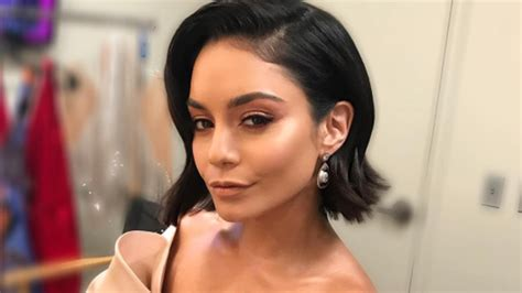 vanessa hudgens has a new haircut with bangs wavy locks