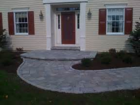 stone front porch and turning walkway landscape authority