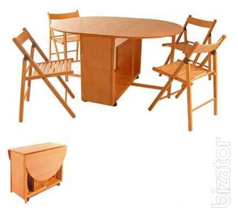 table with 4 chairs inside sell folding table and 4 chairs nested inside the table