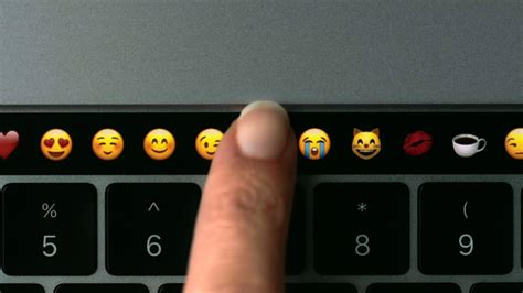 macbook top bar apple unveils macbook pro with touch bar on top of keyboard oct 27 2016