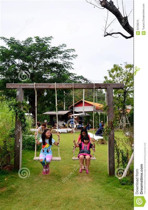 thai swing thai children playing swing in garden editorial image