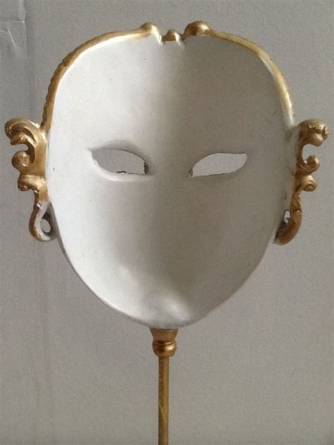 Rd Masker Gold ornately decorated mask on gold stand catawiki