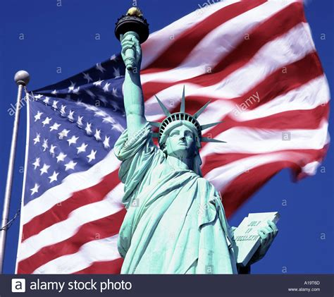 statue of liberty and flag usa york the statue of liberty and us flag stock photo