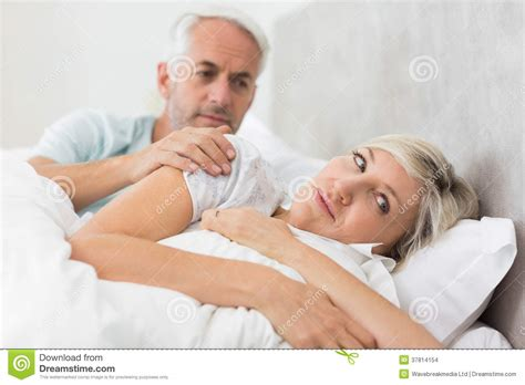 men and women in bed woman ignoring mature man in bed stock images image