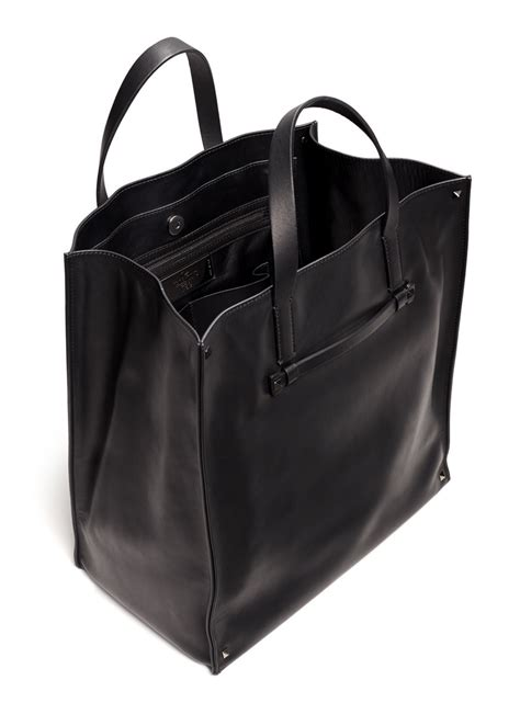 Flypower Pouch Bag Black valentino rockstud leather tote bag in black for lyst