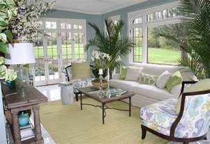 delightful How To Furnish Small Living Rooms #7: soft-blue-sunroom-s-wall-paint-colors-with-white-sofa-and-plants1.jpg