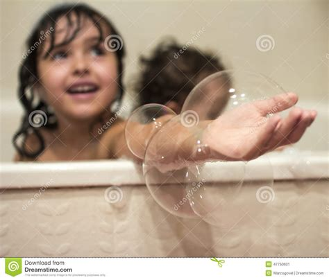 two girls in a bathtub two little girls in the bathtub stock photo image 47750601