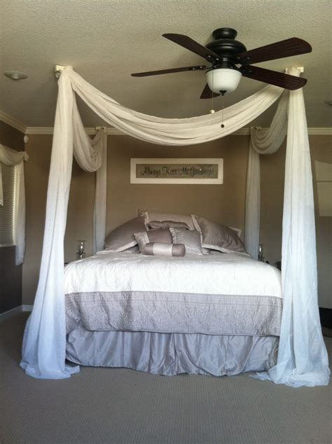 beds that hang from the ceiling my makeshift 4 poster bed simply hang wall sconces on the
