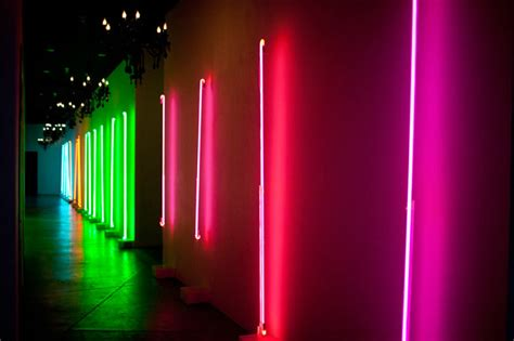 neon light installation on wall the event los angeles green wedding shoes