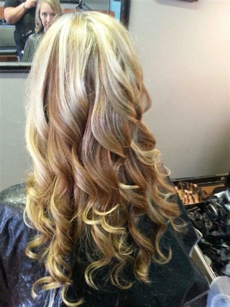 curly hair with lowlights blonde highlights and lowlights hair color long curly hair