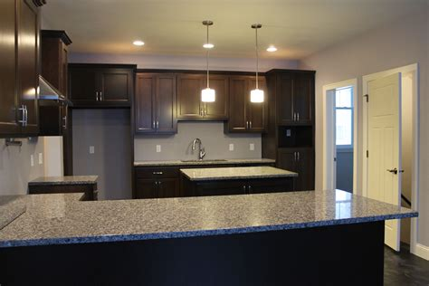 dark cabinets light countertops how to choose between light and dark granite katie jane