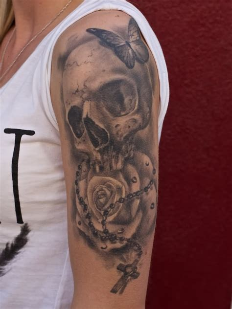 amazing skull and rose tattoo on arm