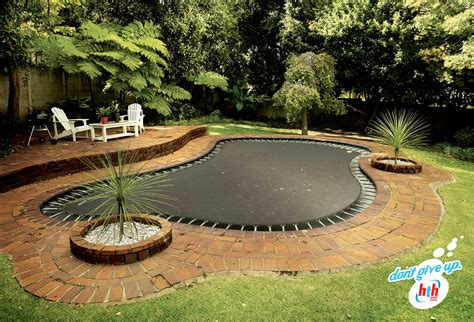 How To Level A Backyard With A Slope Trampoline Garden