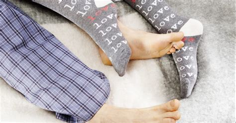 wearing socks to bed why wearing socks in bed is good for you and can make