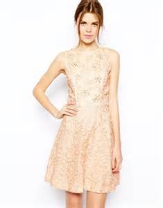 Get Mandy Moores Look With River Islands Lace Mini by Julianne Dons Glittering Gold And Black